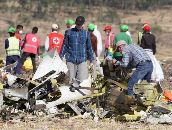 Investigators with the US National Transportation and Safety Board (NTSB) look over debris at the crash site of Ethiopian Airlines Flight ET 30. Image: Bloomberg