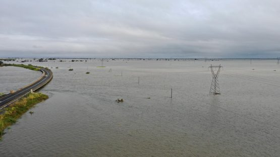 A car drives by a flooded area after Cyclone Idai in Beira, Mozambique March 20, 2019. Picture: CARE International/Josh Estey via Reuters