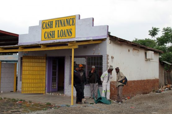 A money lender in Marikana. Reckless lending was one of the main grievances of the 34 striking miners killed by police in the Marikana Massacre in 2012; many were left with virtually nothing on payday after so-called garnishee orders were deducted from their salaries. Picture: Nadine Hutton/Bloomberg