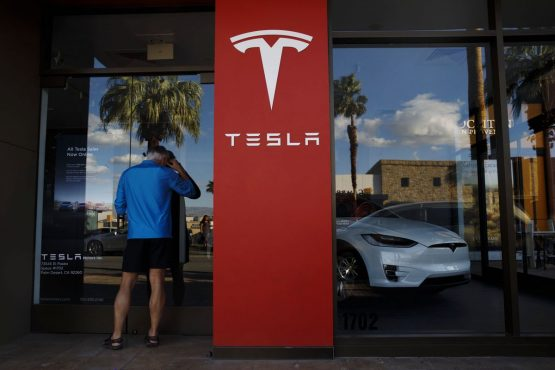 Tesla posts a cash balance increase to $5.3bn and is reporting a profit of $1.86 per share, shattering analyst expectations for a loss of 42 cents per share. Image: Bloomberg