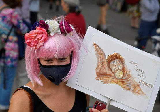 A woman holds a placard during the Extinction Rebellion protest on Oxford Street, near Marble Arch in London on April 22, 2019. Picture:   Reuters/Toby Melville