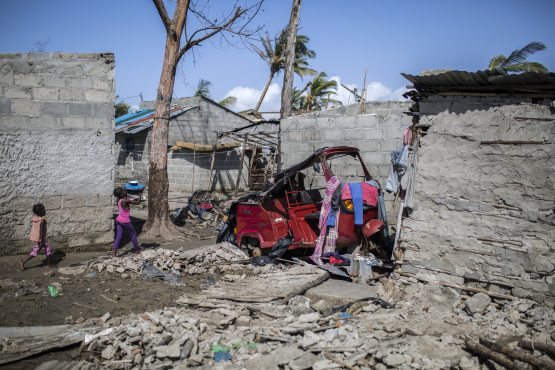 Children walk through rubble and debris from damaged houses in a residential neighborhood following the cyclone in Beira, Mozambique. Picture: Guillem Sartorio/Bloomberg