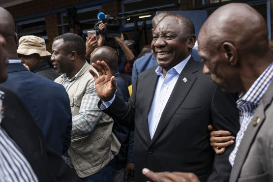 Cyril Ramaphosa, second right, greets supporters as he arrives to cast his vote at a polling station during the general election in Soweto on Wednesday, May 8, 2019. Picture: Waldo Swiegers/Bloomberg