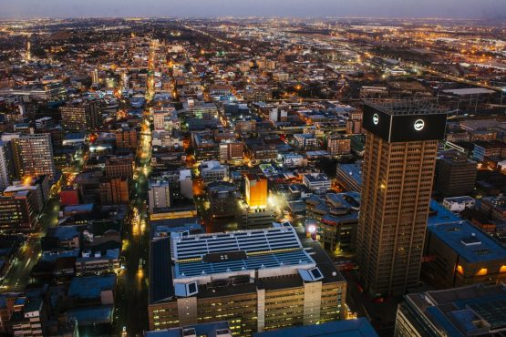 Commercial buildings and office property stand on the city skyline as night falls, as seen from the 50th floor of the Carlton Centre, in Johannesburg. Picture: Waldo Swiegers/Bloomberg
