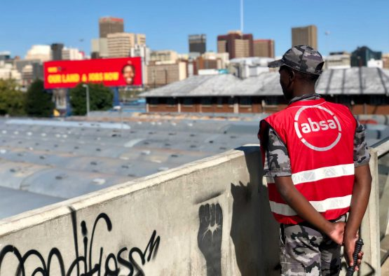 An Absa security guard patrols on Nelson Mandela bridge in Johannesburg. Picture: Vernon Wessels/Bloomberg