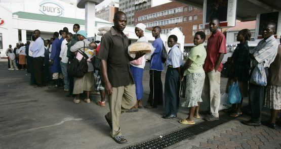 Queuing for bread in Harare. One of Zimbabwe's biggest bakeries stopped baking because it could not get wheat. Picture: Philimon Bulawayo/Reuters