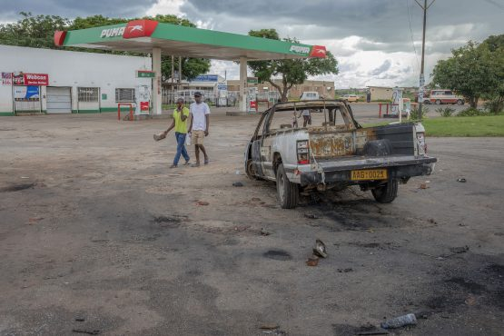 A burnt-out shell of a pick-up truck lies on the forecourt of a closed Puma Energy gas station in Harare, Zimbabwe. Piture: Cynthia R Matonhodze/Bloomberg