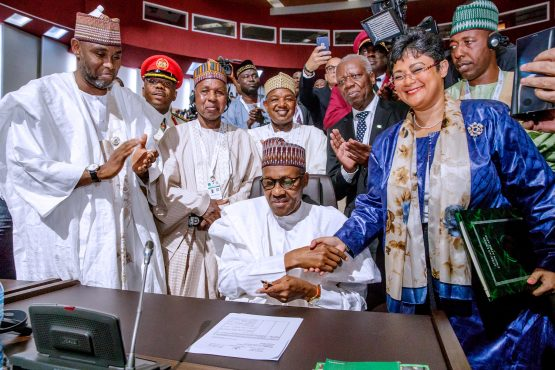 Nigerian President Muhammadu Buhari signs an agreement ahead of the launching of the African Continental Free Trade Area (AfCFTA). Picture: Reuters