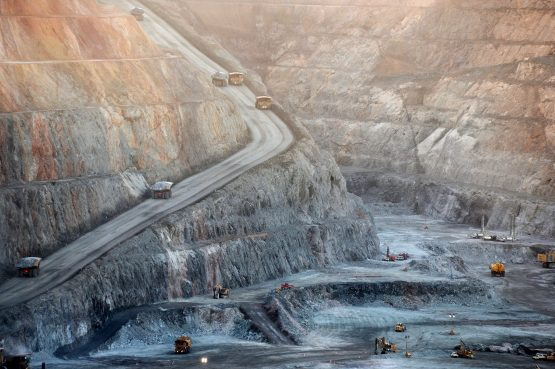 Mining trucks and machinery operate in the Fimiston Open Pit, known as the Super Pit, in Kalgoorlie, Australia. Picture: Carla Gottgens