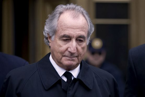 Bernard Madoff is led out from Federal court on Tuesday, March 10, 2009 in New York. Image: Bloomberg