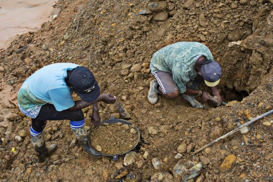 People pan illegally for gold at a site near the city of Quibdo, Colombia. Picture: Nicolo Filippo Rosso, Bloomberg