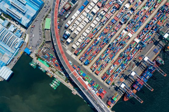 Container ships are docked as shipping containers sit in the Dongbu Pusan Container Terminal Co terminal at the Port of Busan