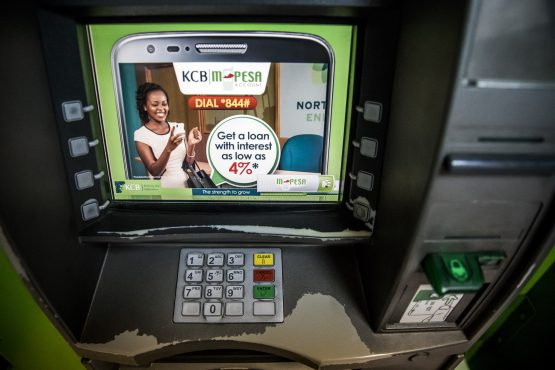 An automated teller machine displays M-Pesa banking service information outside a bank branch in Mombasa. Picture: Luis Tato/Bloomberg