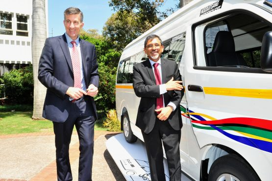 Toyota's Andrew Kirby (left) and Minister of Trade, Industry and Competition Ebrahim Patel, pictured on Friday with one of the HiAce Ses'fikile models. Image: Supplied