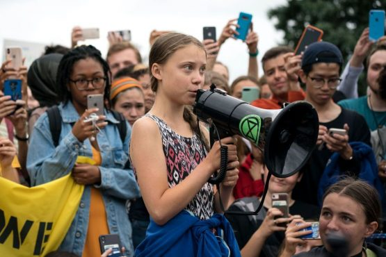 Swedish teenage activist Greta Thunberg speaks during a strike to demand action be taken on climate change outside the White House in September. Image: Getty Images