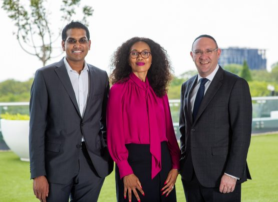 Sindi Mabaso-Koyana, AWCA Investment Holdings executive chair (centre), with Vukile Property Fund CEO Laurence Rapp (right) and RMB's Sashen Nadioo (left). The group has secured a R700m property portfolio from Vukile as part of a landmark empowerment deal. Image: Supplied