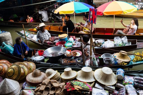 Vendors and tourists on boats at the floating market in Damnoen Saduak, Thailand. Image: Bloomberg