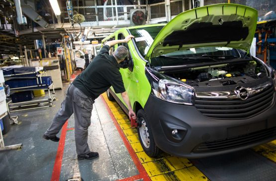 An employee checks the front wheel of a Vauxhall Vivaro medium sized van on the final assembly line at the Vauxhall plant in Luton, UK, Image: Chris Ratcliffe/Bloomberg