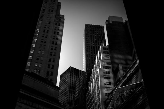 Buildings stand on Wall Street near the New York Stock Exchange in New York. Image: John Taggart