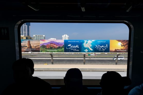 A billboard advertisement featuring Saudi Arabian tourism on Sheikh Zayed Road seen from the metro in Dubai, United Arab Emirates. Image: Christopher Pike/Bloomberg