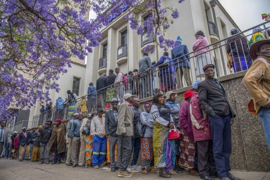 Pensioners queue up early in the morning at a bank in Harare's central business district to withdraw their pensions. Image: Bloomberg