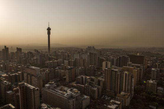 The city skyline at dusk in Johannesburg. Image: Guillem Sartorio, Bloomberg