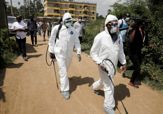 Kenyan health workers dressed in protective suits walk after disinfecting the residence where Kenya's first confirmed coronavirus patient was staying, in the town of Rongai near Nairobi, Kenya March 14, 2020. Image: Reuters