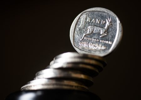 Rand edges lower in cautious trade