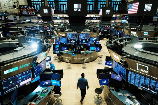 Traders work on the floor of the NYSE on March 20, 2020 in New York City. Image: Spencer Platt/Getty Images North America
