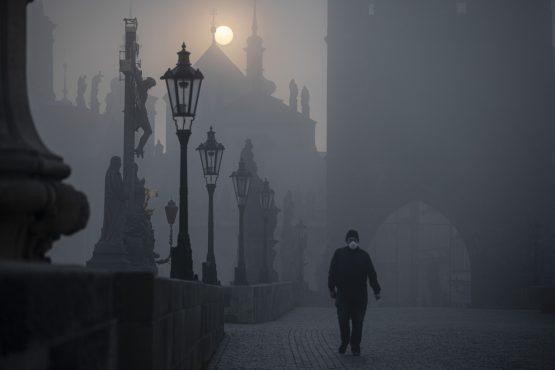 A pedestrian crosses a bridge in Prague during the Czech Republic's lockdown. Image: Milan Jaros, Bloomberg