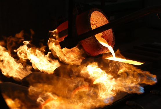 Molten gold pours from a crucible into a mold during the casting of large gold ingots in the foundry at the JSC Krastsvetmet non-ferrous metals plant in Krasnoyarsk, Russia. Image: Andrey Rudakov/Bloomberg