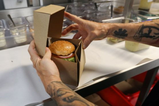 A chef with Gourmet Burger Kitchen delivery-only kitchen. Image: Luke MacGregor, Bloomberg