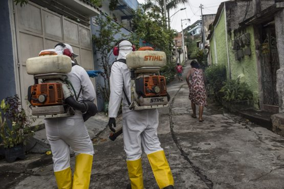Workers disinfect a street surrounding a hospital in Niteroi, Rio de Janeiro state, Brazil, on Monday, March, 30, 2020. Image: Bloomberg