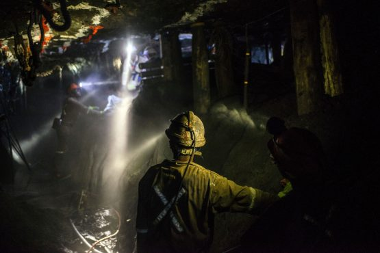 Lights from miners safety helmets illuminate the mine shaft during a media tour of the Sibanye-Stillwater Khuseleka platinum mine, operated by Sibanye Gold. Image: Bloomberg
