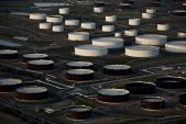 Oil drops to 21-year low with storage filling as demand shrivels