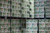 Heineken warns weak emerging market currencies to cut profit