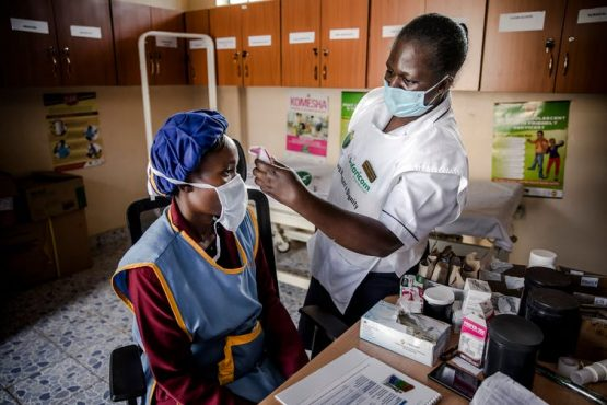 A doctor measures a worker's temperature in Kitui, Kenya. With technology, AI and human resources, Africa's health systems can take on Covid-19. Image Luis Tato/AFP via Getty Images