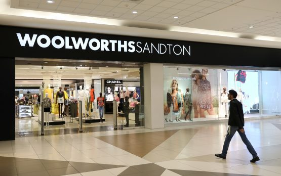 A shopper walks to a Woolworths store in Sandton, South Africa. Image: Reuters