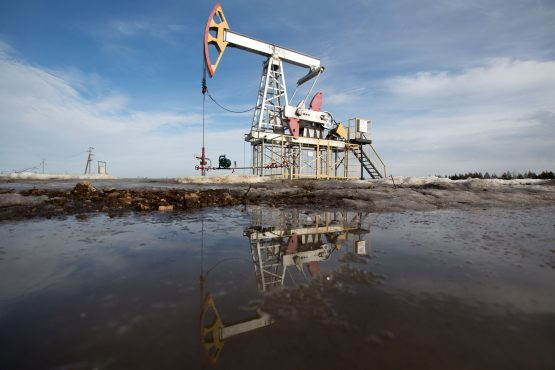 An oil pumping jack also known as'nodding donkey, stands in an oilfield near Almetyevsk Tatarstan Russia. Image Andrey Rudakov  Bloomberg