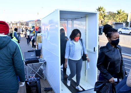 Walk-through sanitising booth sprays SA commuters