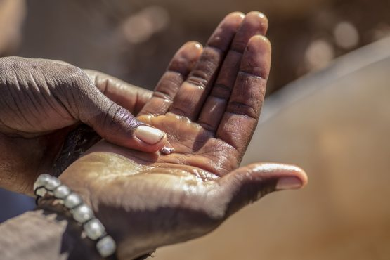 A small piece of gold emerges after mercury is used to separate gold particles from the ore powder at a small-scale gold mine in Umguza, Zimbabwe. Image: Cynthia Matonhodze/Bloomberg