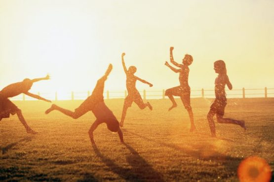 Children aged 0-14 years are likely to be physically active outdoors when it's warm. Image: Hello World/Getty Images