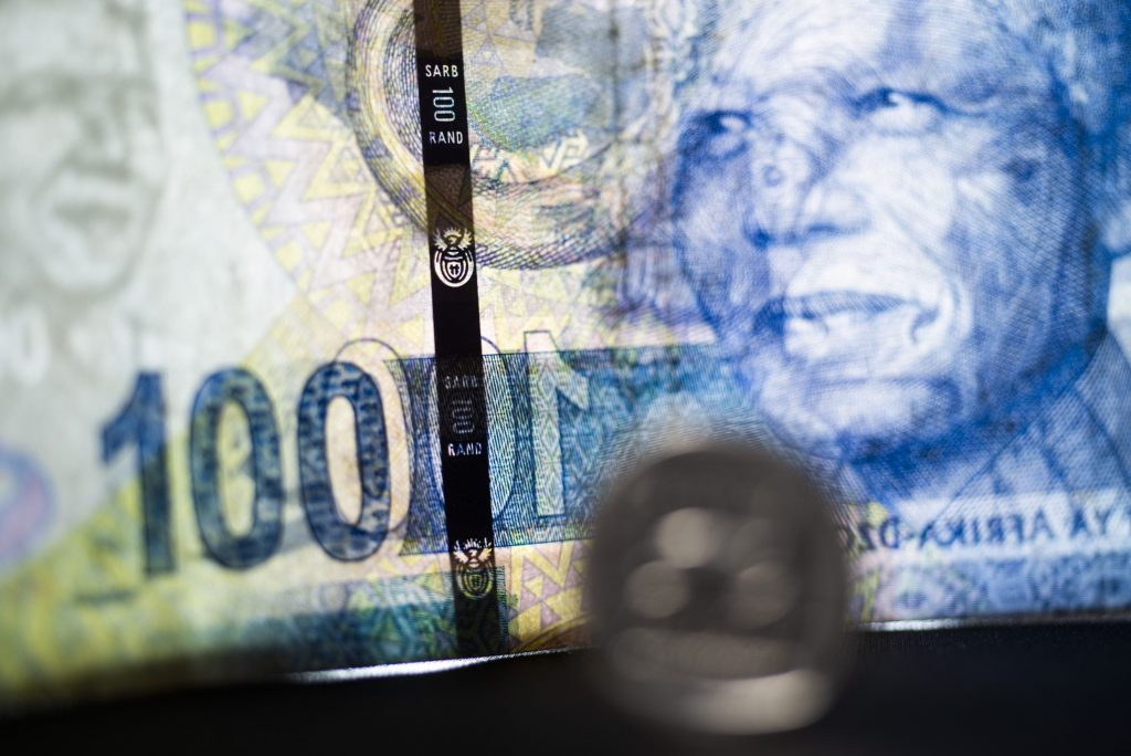 Rand gains as global bond market calms