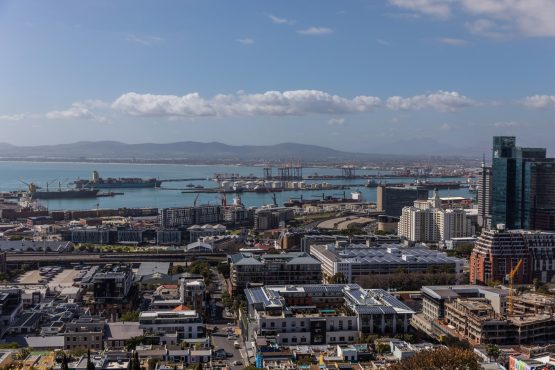 The port area stands beyond commercial high-rise properties in Cape Town. Image: Dwayne Senior/Bloomberg