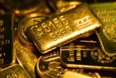 Gold drops as investors weigh stimulus prospects, virus cases