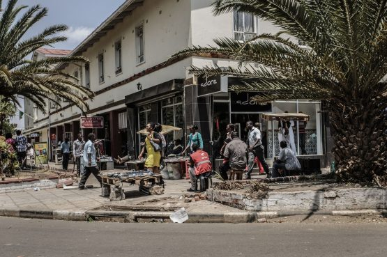 Vendors wait for customers on a sidewalk in the central Lusaka Businness district. Image: Gianluigi Guercia/Getty Images