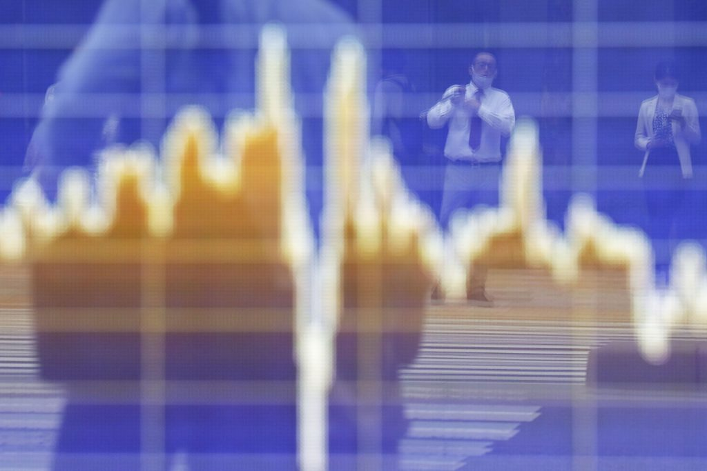 Stocks fluctuate; oil tumbles on virus concerns: markets wrap