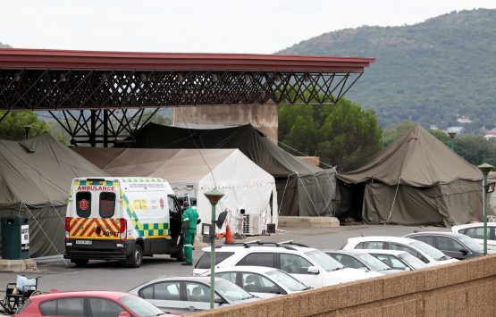An ambulance is parked near tents erected in the parking lot of the Steve Biko Academic Hospital in Pretoria on January 11. Image: Siphiwe Sibeko, Reuters