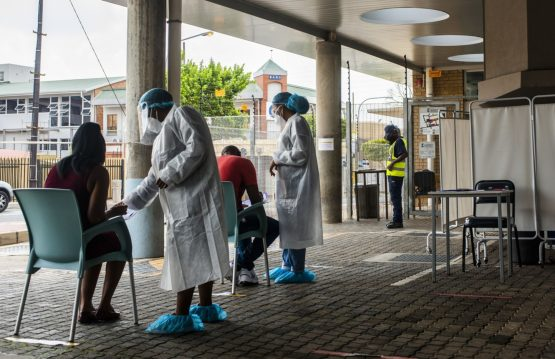 Health workers register patients at a Covid-19 testing station in the Richmond suburb of Johannesburg, on February 10, 2021. Image: Bloomberg