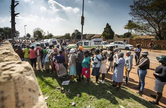 People queue for food aid south of Johannesburg. The impact of Covid-19 on people's livelihoods has been severe. Image: Waldo Swiegers/Bloomberg via Getty Images